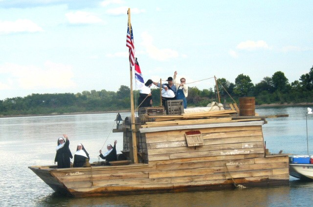 Group of People on a Wooden Flatboat